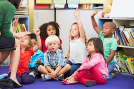 children-sitting-on-the-floor-in-a-classroom