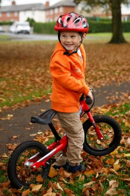 boy-with-a-bike-in-autumn