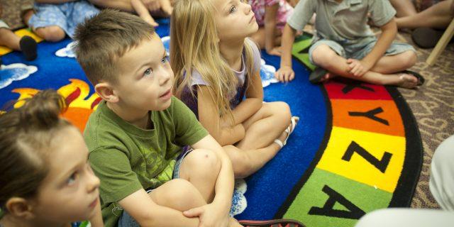 children-listening-to-teacher