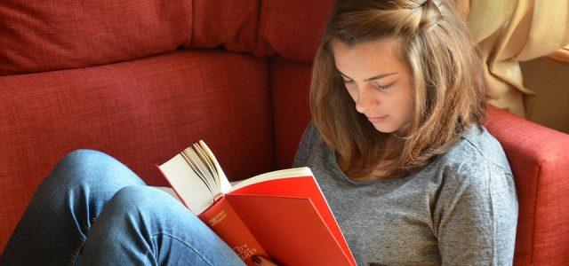woman-reading-a-novel-at-home