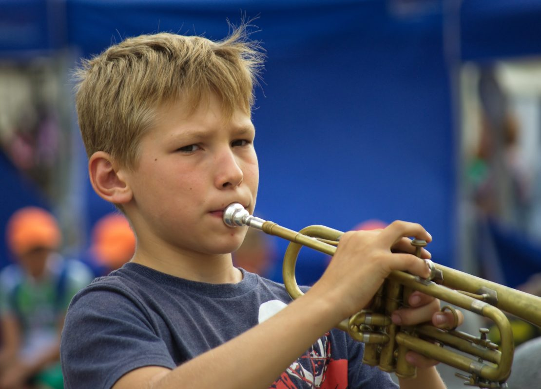 boy-playing-musical-instrument