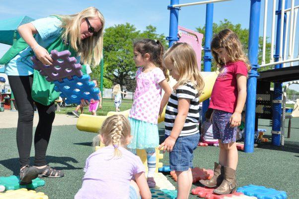 children-and-teacher-at-the-playground