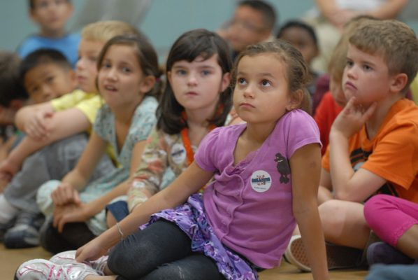 children-listening-on-the-floor