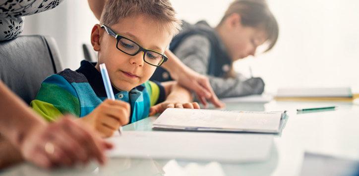 teacher-helping-a-schoolboy