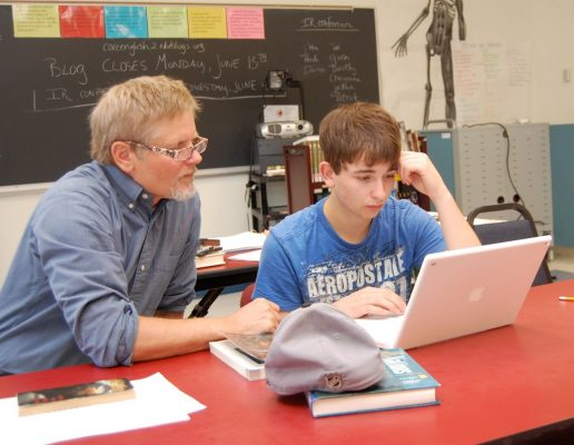 teacher-and-student-in-front-of-a-laptop