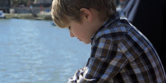 boy-thinking-near-a-river