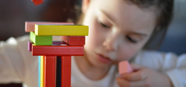 child-playing-with-wooden-blocks