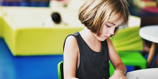 sad-girl-writing-at-school