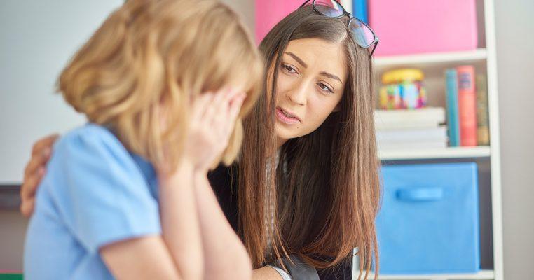 teacher-comforting-student