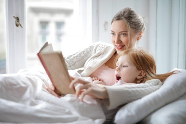 mother-and-daughter-reading-in-bed